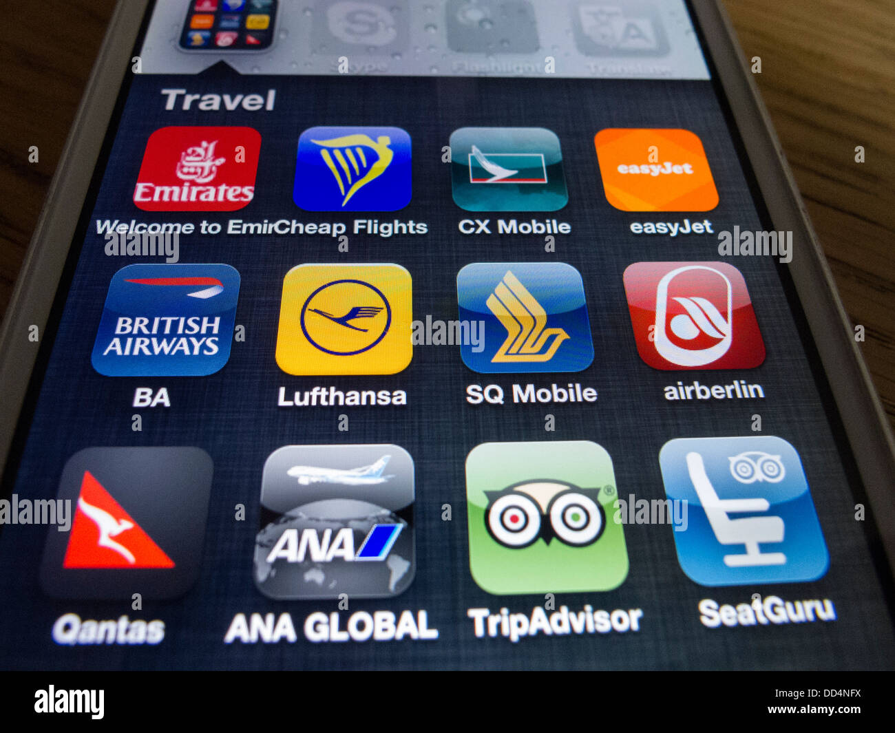 Detail of many travel and airline apps on an iPhone 5 smart phone - Stock Image