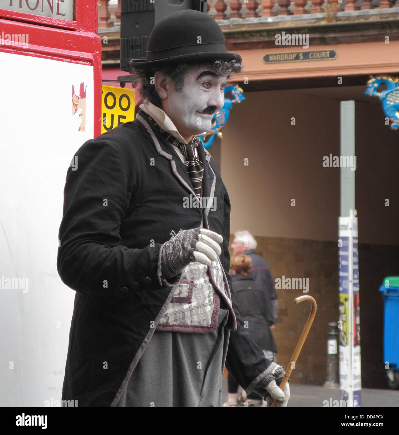 Charlie Chaplin Impersonator during the Edinburgh Fringe Festival, Lawnmarket, The Royal Mile, Edinburgh, Scotland, - Stock Image