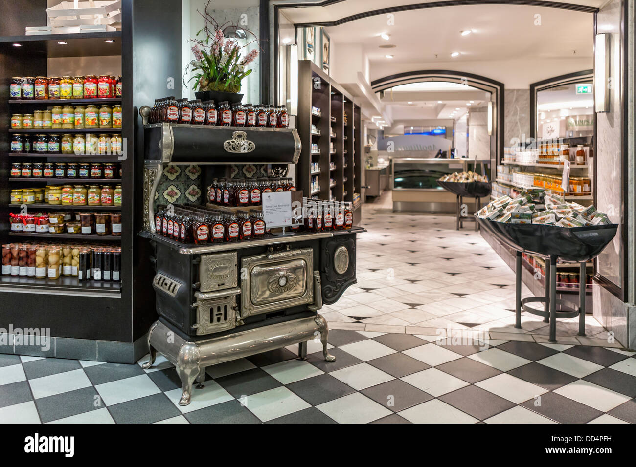 Old stove and checked black and white flooring in food department of the Kaufhaus des Westens, Kadewe, Tauentzienstrasse, - Stock Image