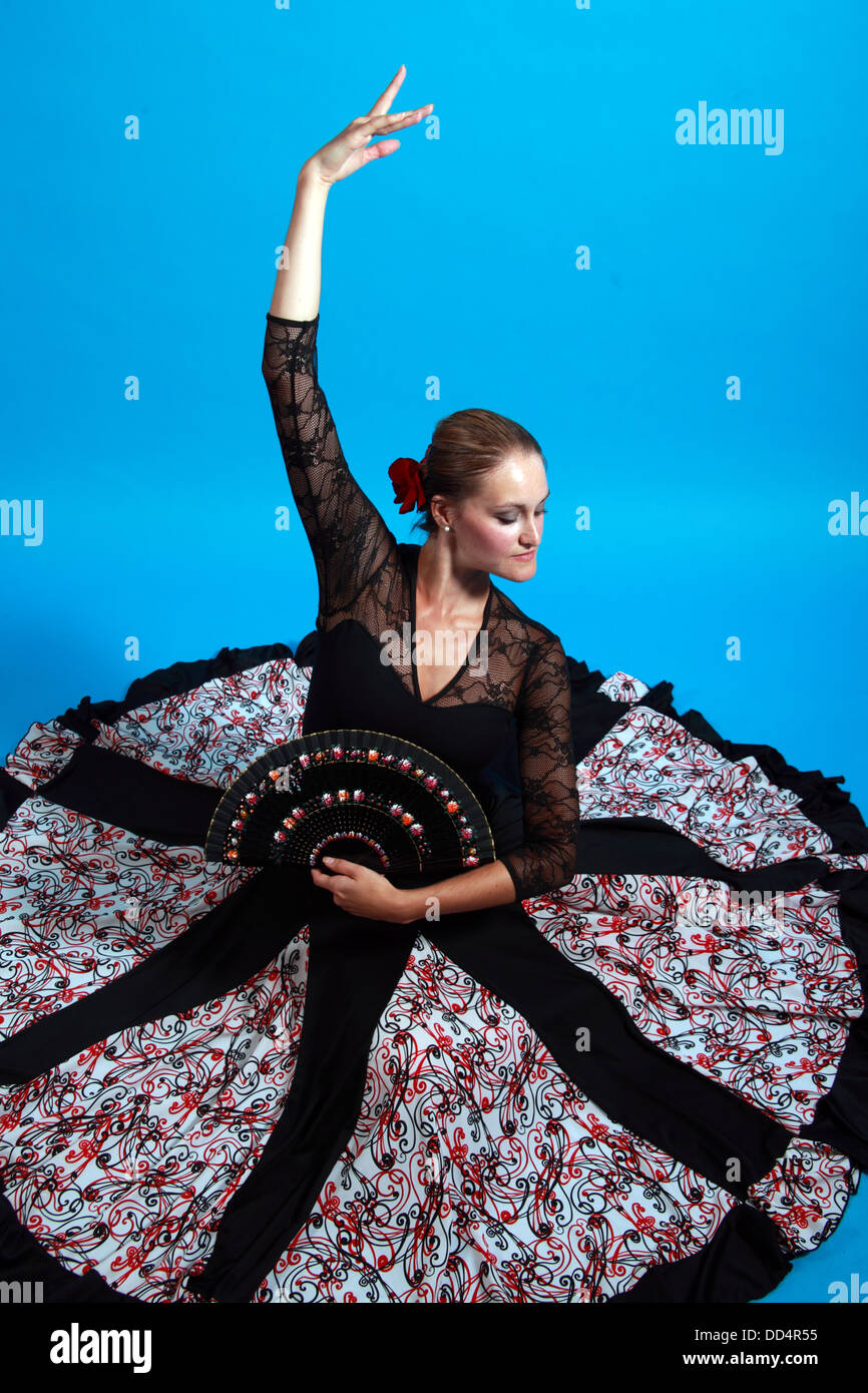 Flamenco dance moves, lady in a black dress with fan - Stock Image