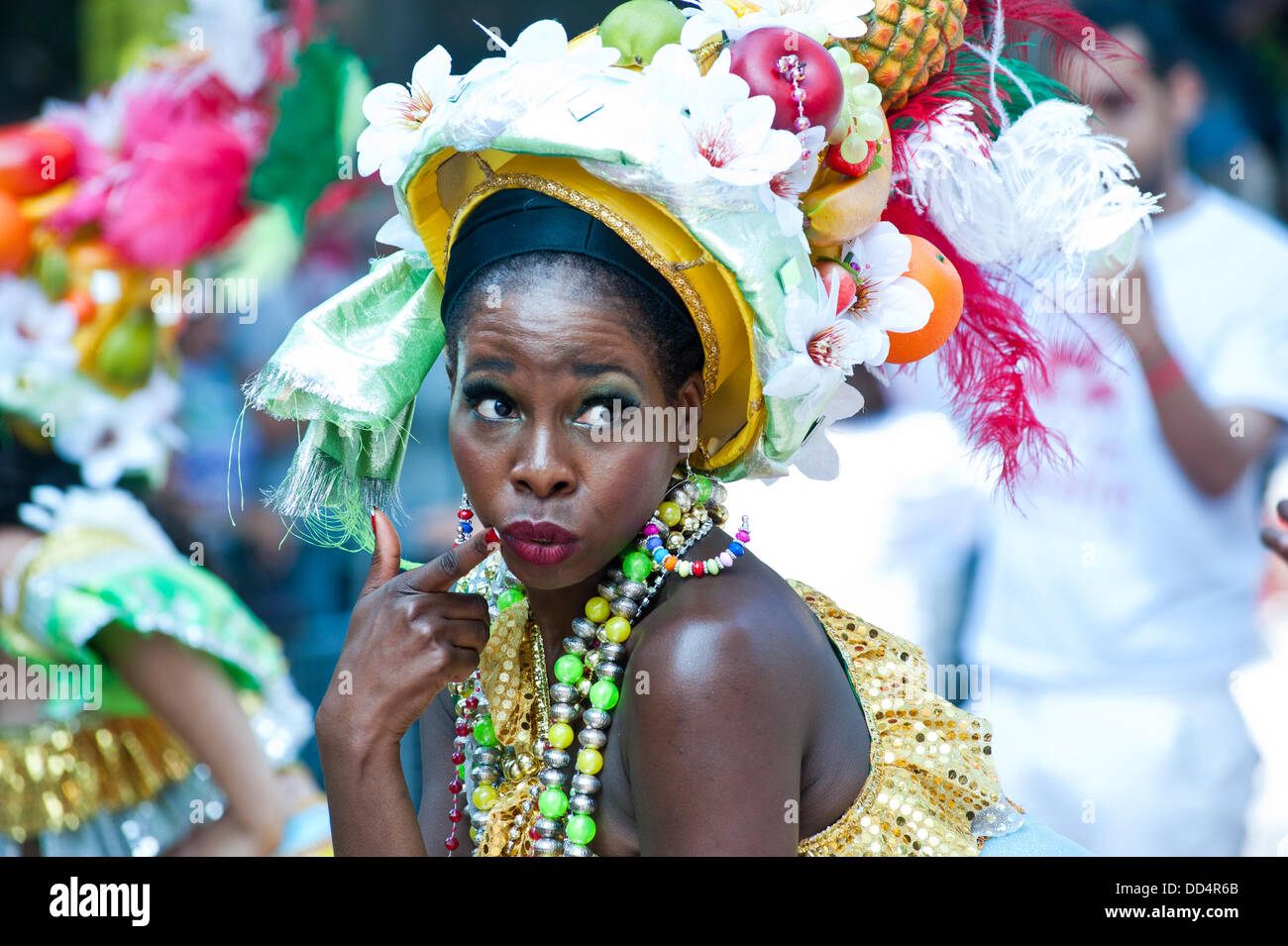London, UK. 26th Aug, 2013. revellers take part in the annual parade at the Notting Hill Carnival. Credit:  Piero - Stock Image