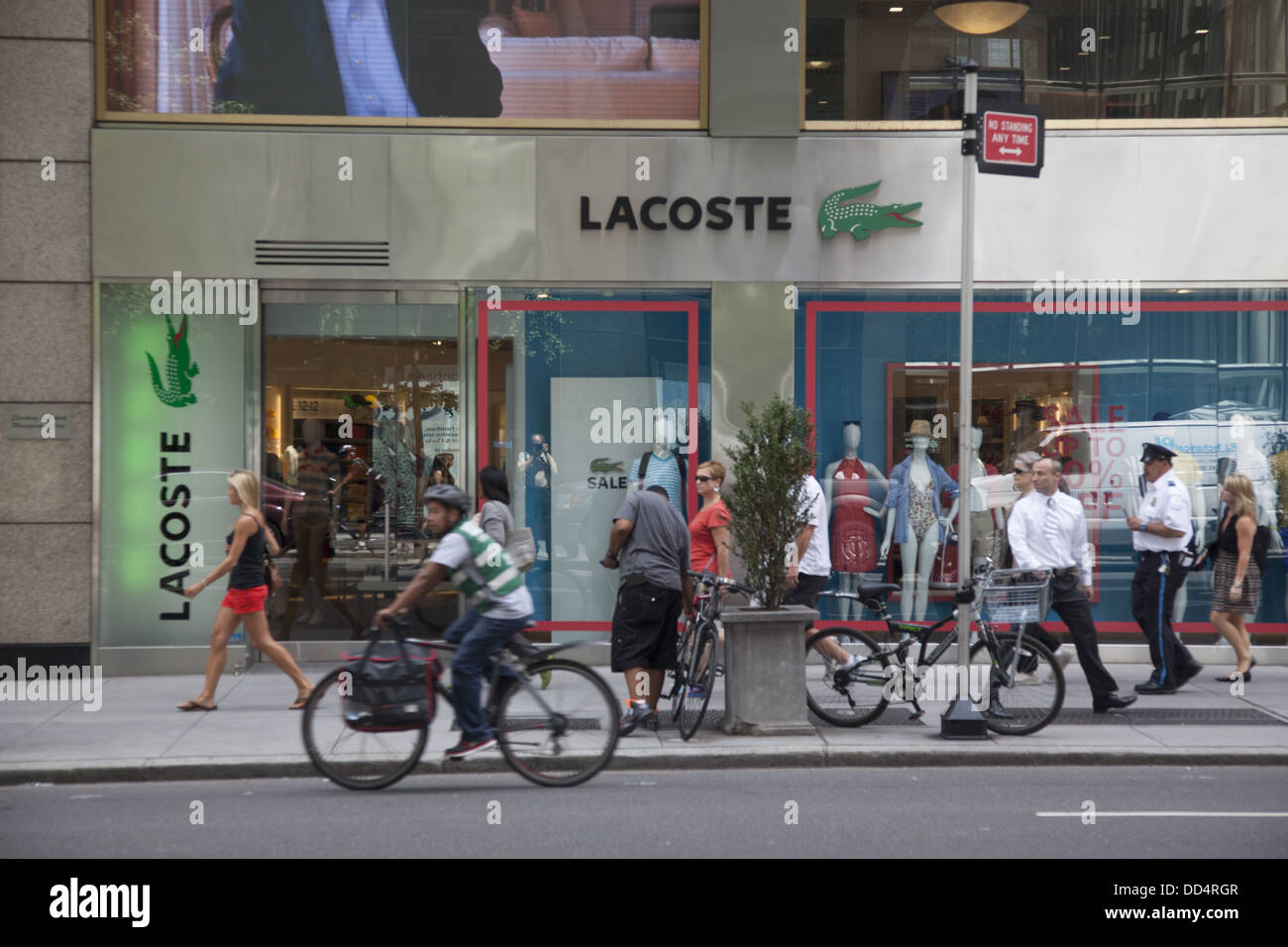 1a9053a374a181 People walk passed LACOSTE store along 5th Avenue in New York City ...