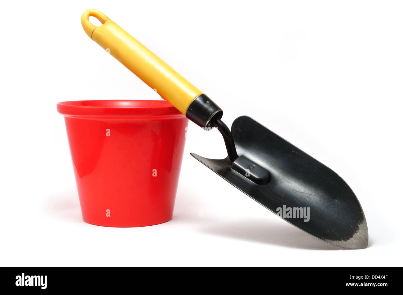 Garden Trowel and Red Ceramic Flower Pot Isolated On A White Background - Stock Image