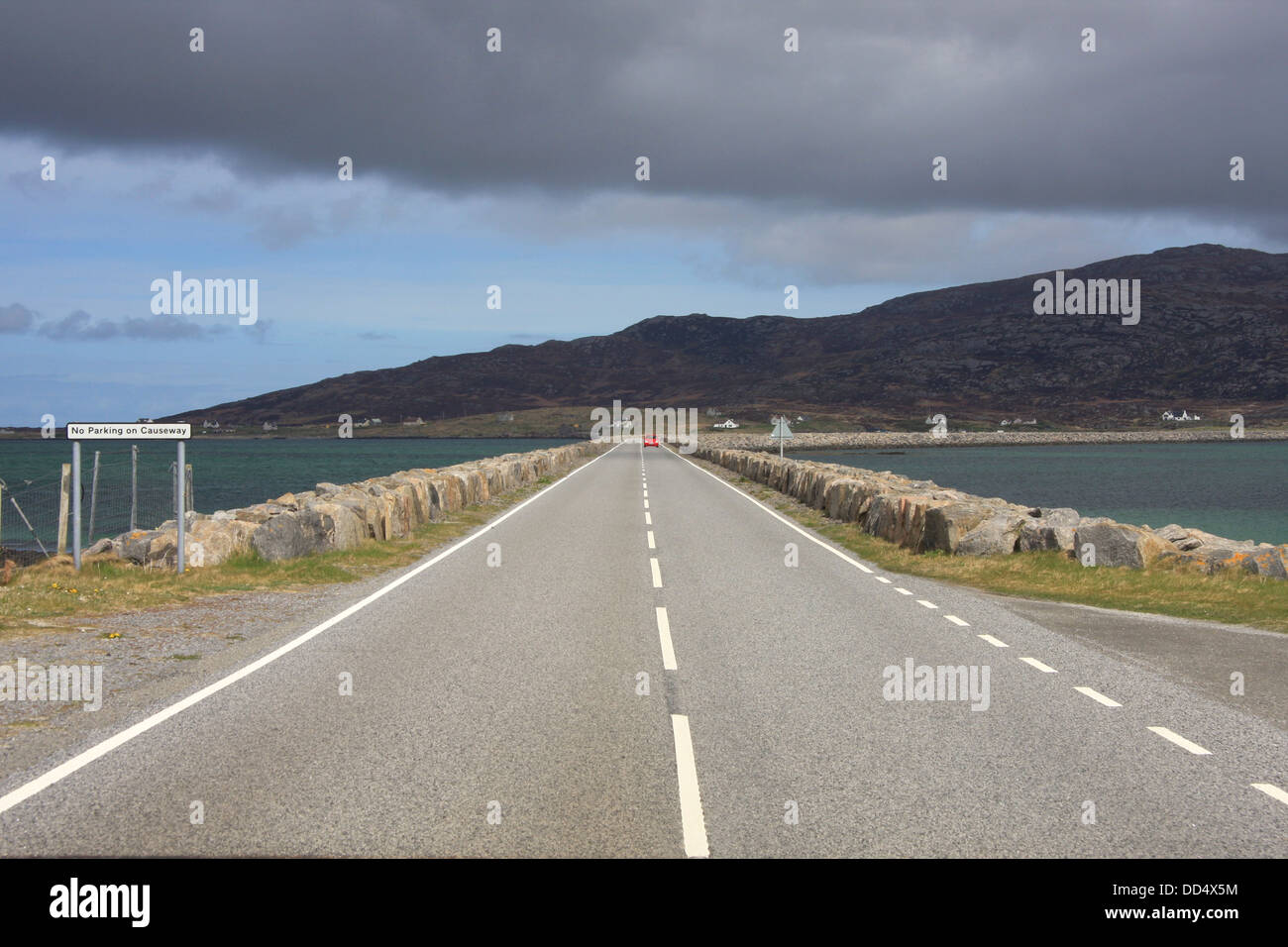 Eriskay causeway - the road linking the Isle of Eriskay to South Uist in the Outer Hebrides, Scotland - Stock Image