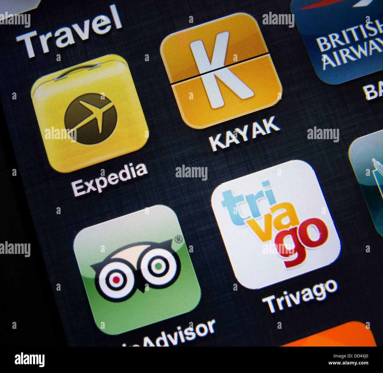 detail of many travel apps on a iPhone 5 smart phone - Stock Image