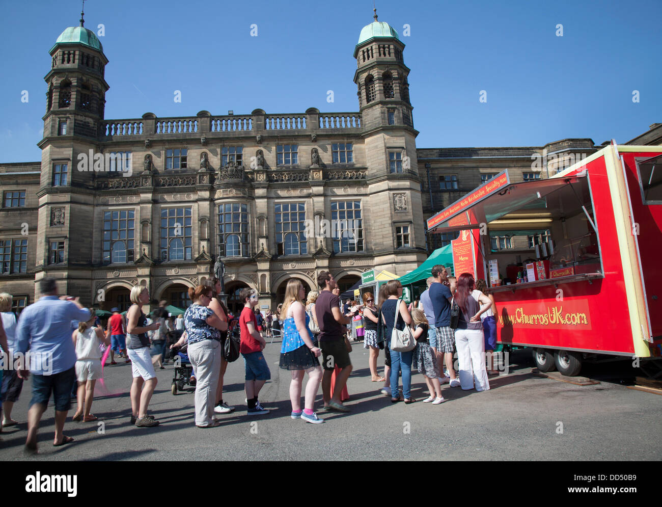 Queue outside Stonyhurst College, for churros at Clitheroe, UK. 26th August, 2013. Food queues at the Great British - Stock Image