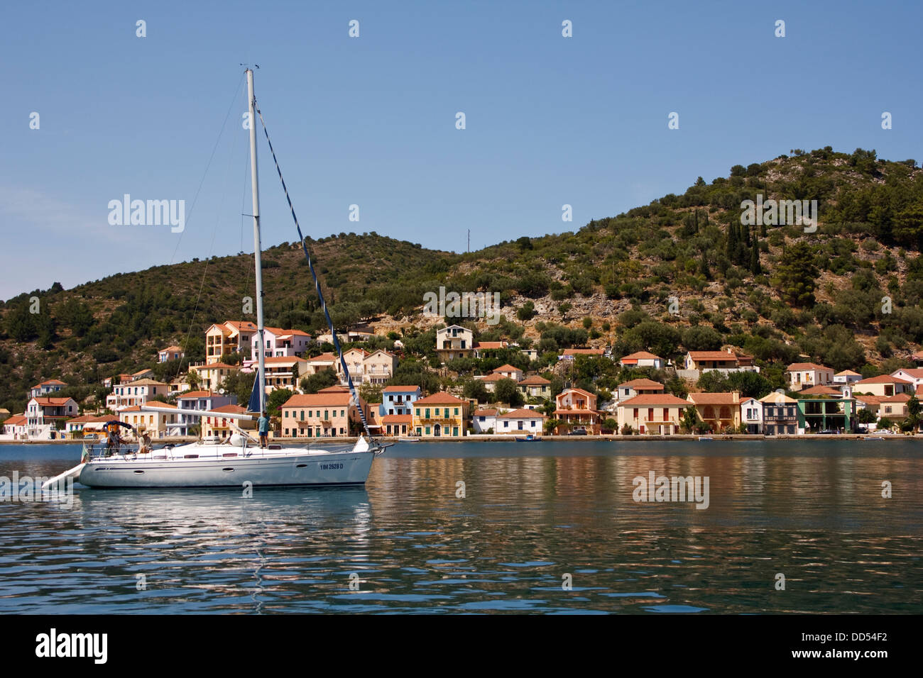 A sailing yacht in the bay at Vathy, on the Greek island of Ithaca. - Stock Image
