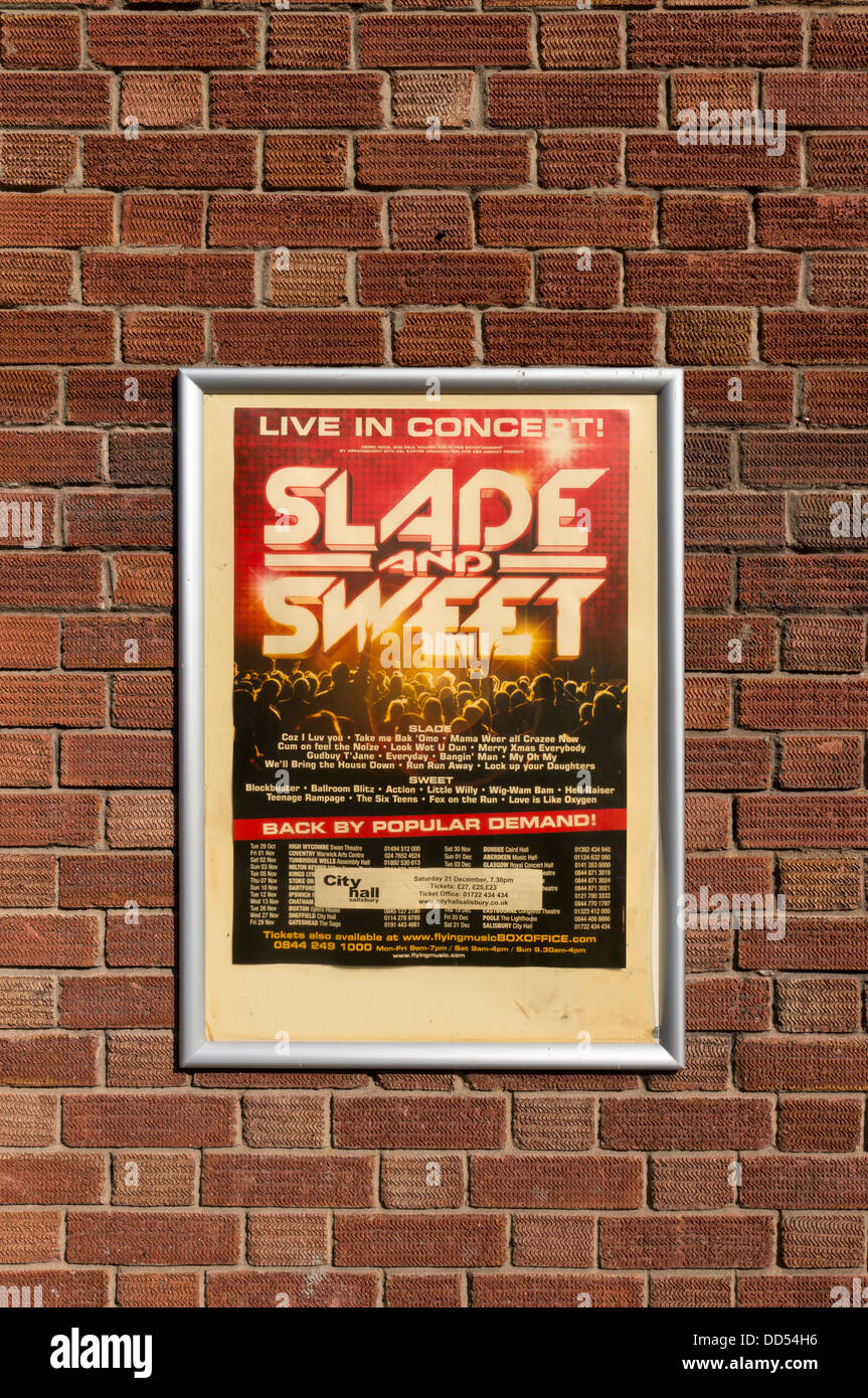 Framed poster advertising 70's British pop groups Slade and Sweet in concert UK Stock Photo