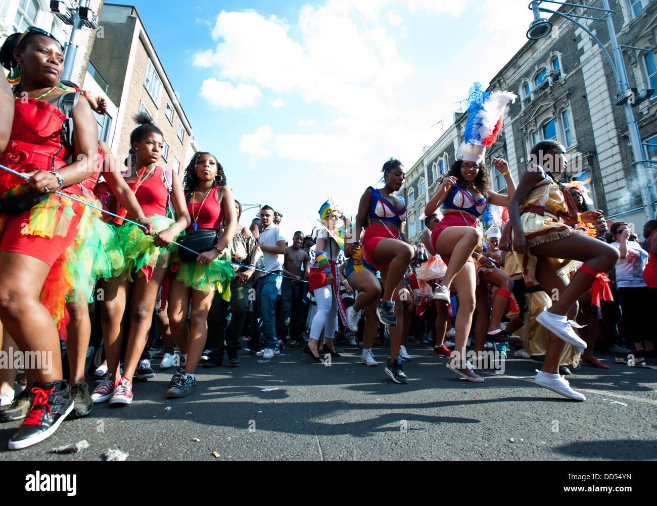 London, UK - 26 August 2013: revellers dance during the annual parade at the Notting Hill Carnival. Stock Photo