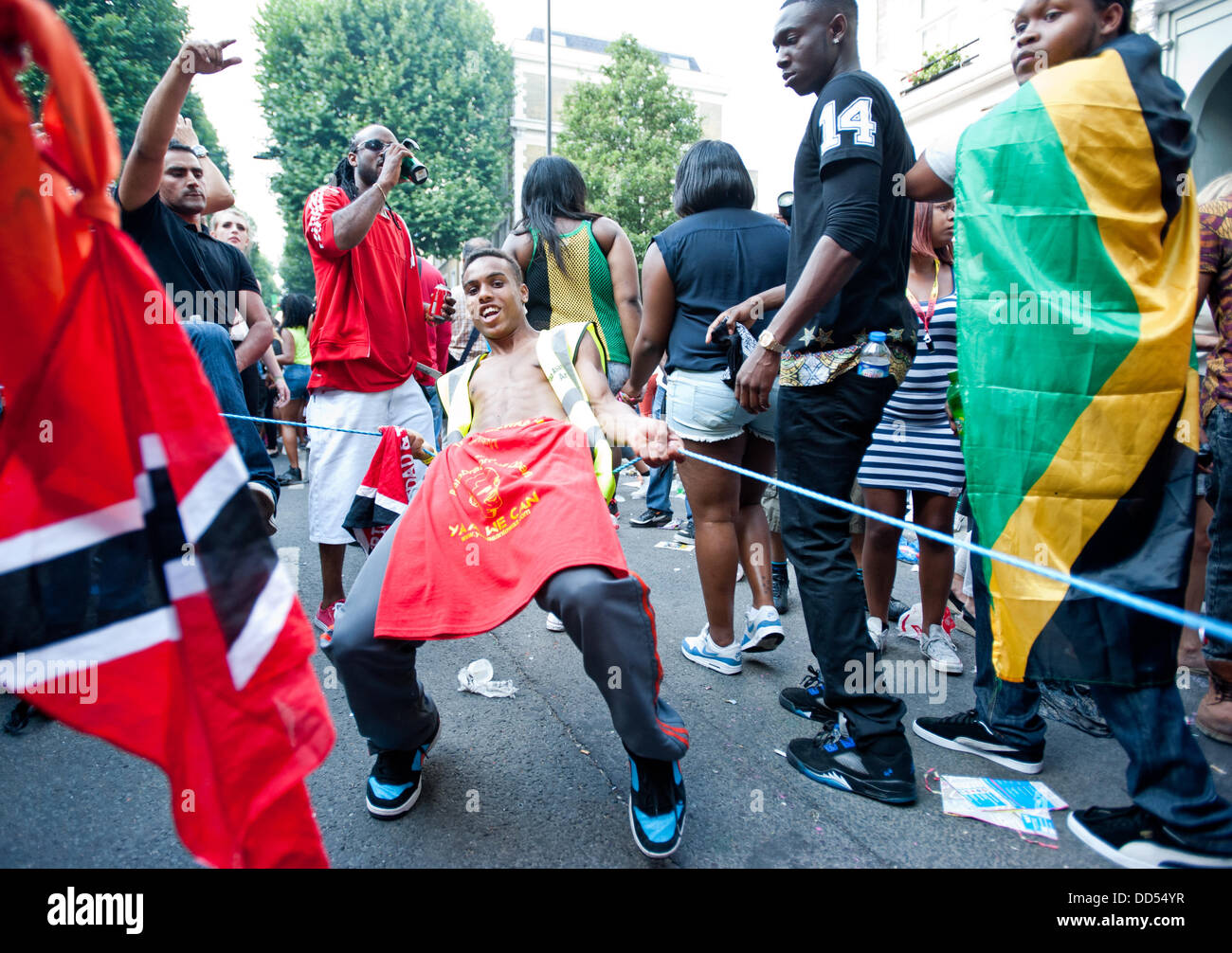 London, UK - 26 August 2013:  a young man dances during the annual parade at the Notting Hill Carnival. Stock Photo