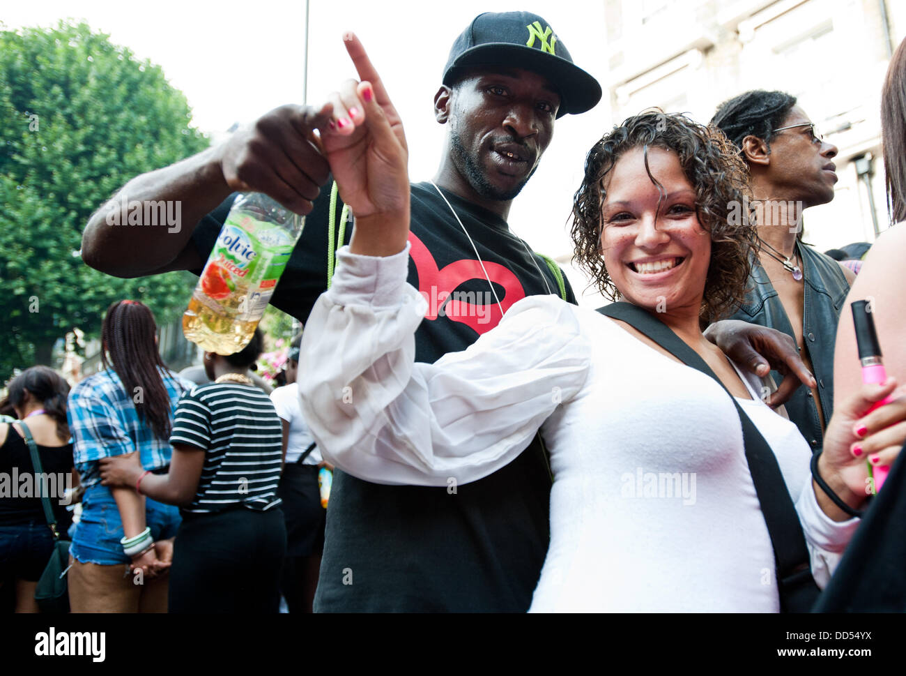 London, UK - 26 August 2013: two revellers dance for the camera during the annual parade at the Notting Hill Carnival. - Stock Image