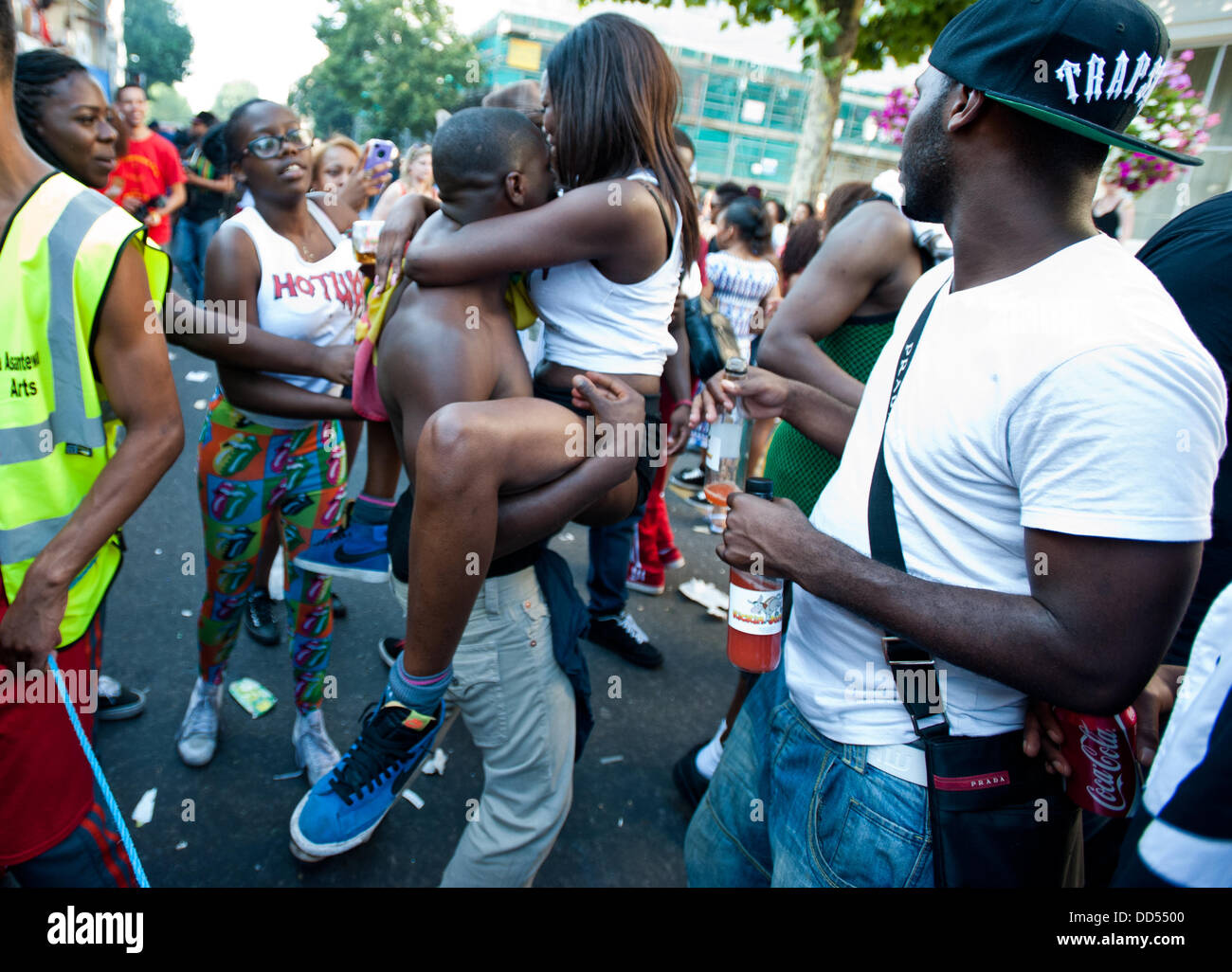 London, UK - 26 August 2013: a couple of revellers dance in front of the camera during the annual parade at the - Stock Image