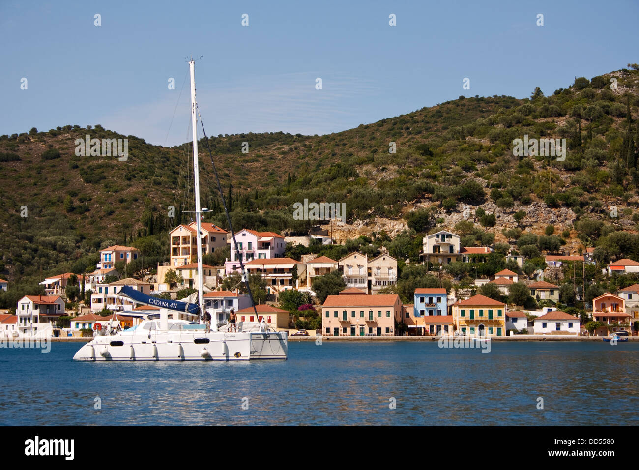 A sailing catamaran in the bay at Vathy, on the Greek island of Ithaca. - Stock Image