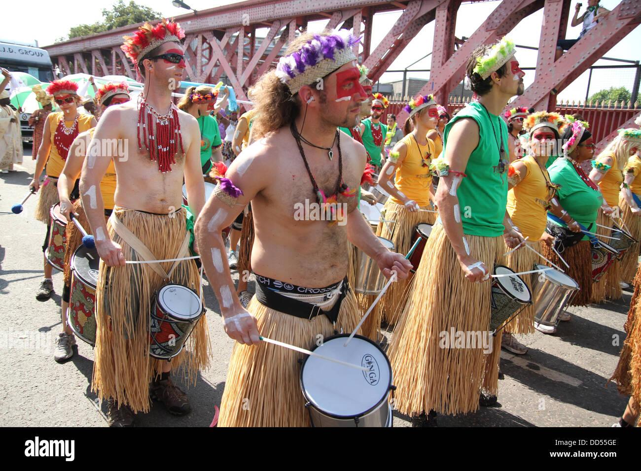 London, UK. 26 August 2013. Drummers entertain crowds on Kensal Road. Credit: David Mbiyu/ Alamy Live News Stock Photo