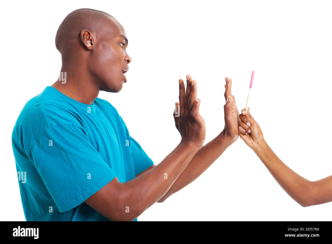 African American man denying girlfriend's pregnancy isolated on white background - Stock Image