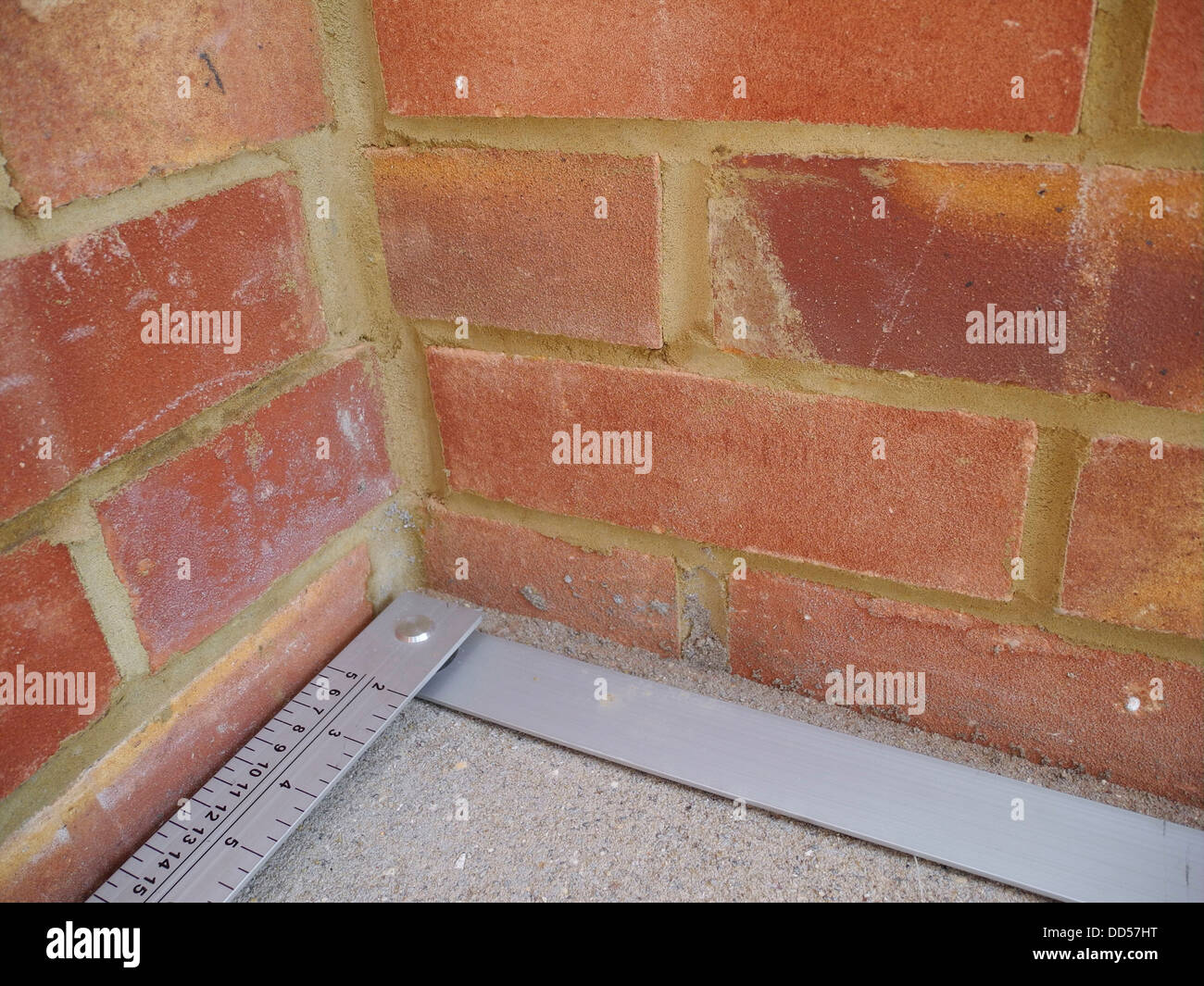 Bad brickwork badly laid bricks - Stock Image