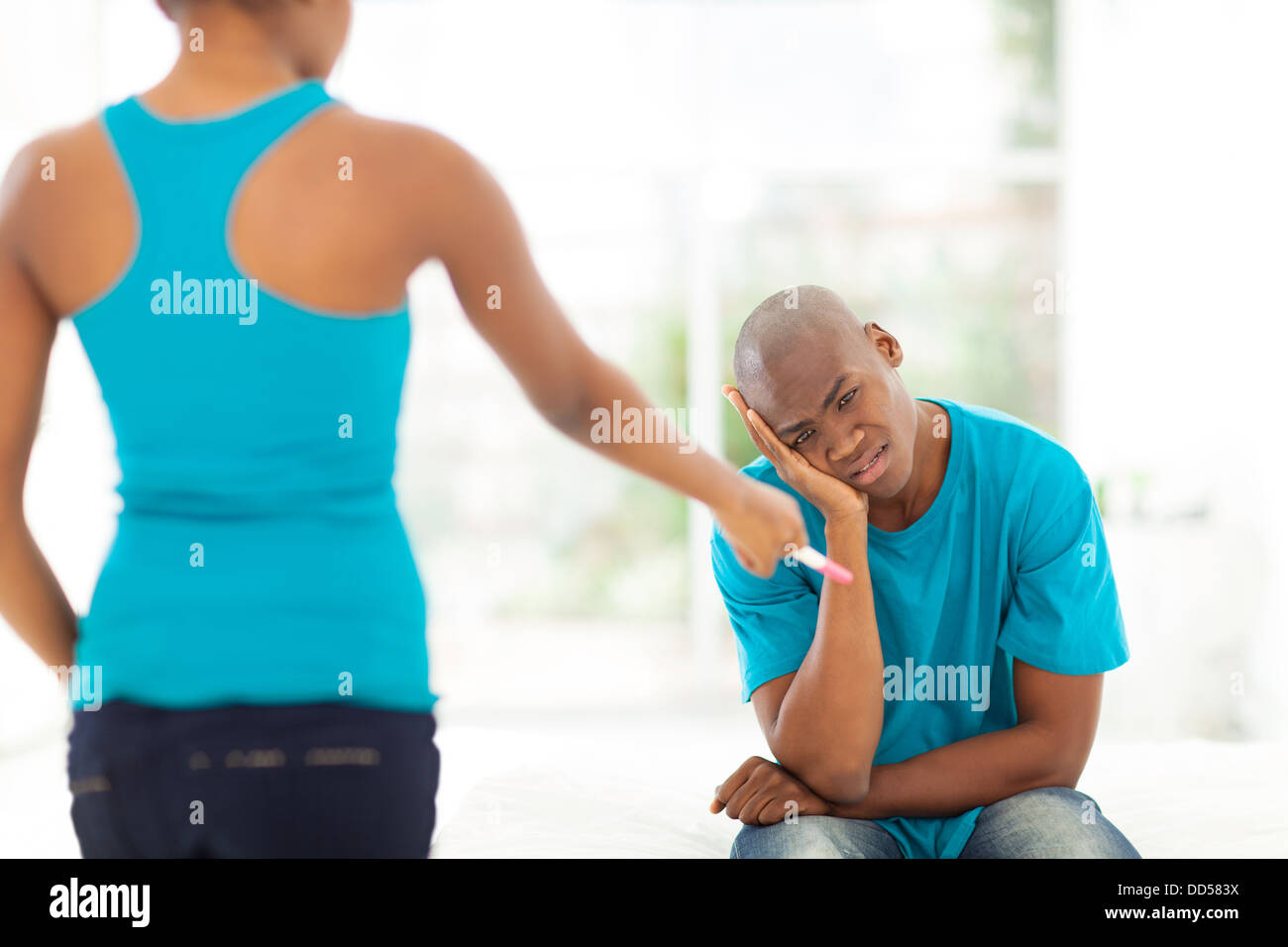 young African man feel hopeless when girlfriend is pregnant - Stock Image