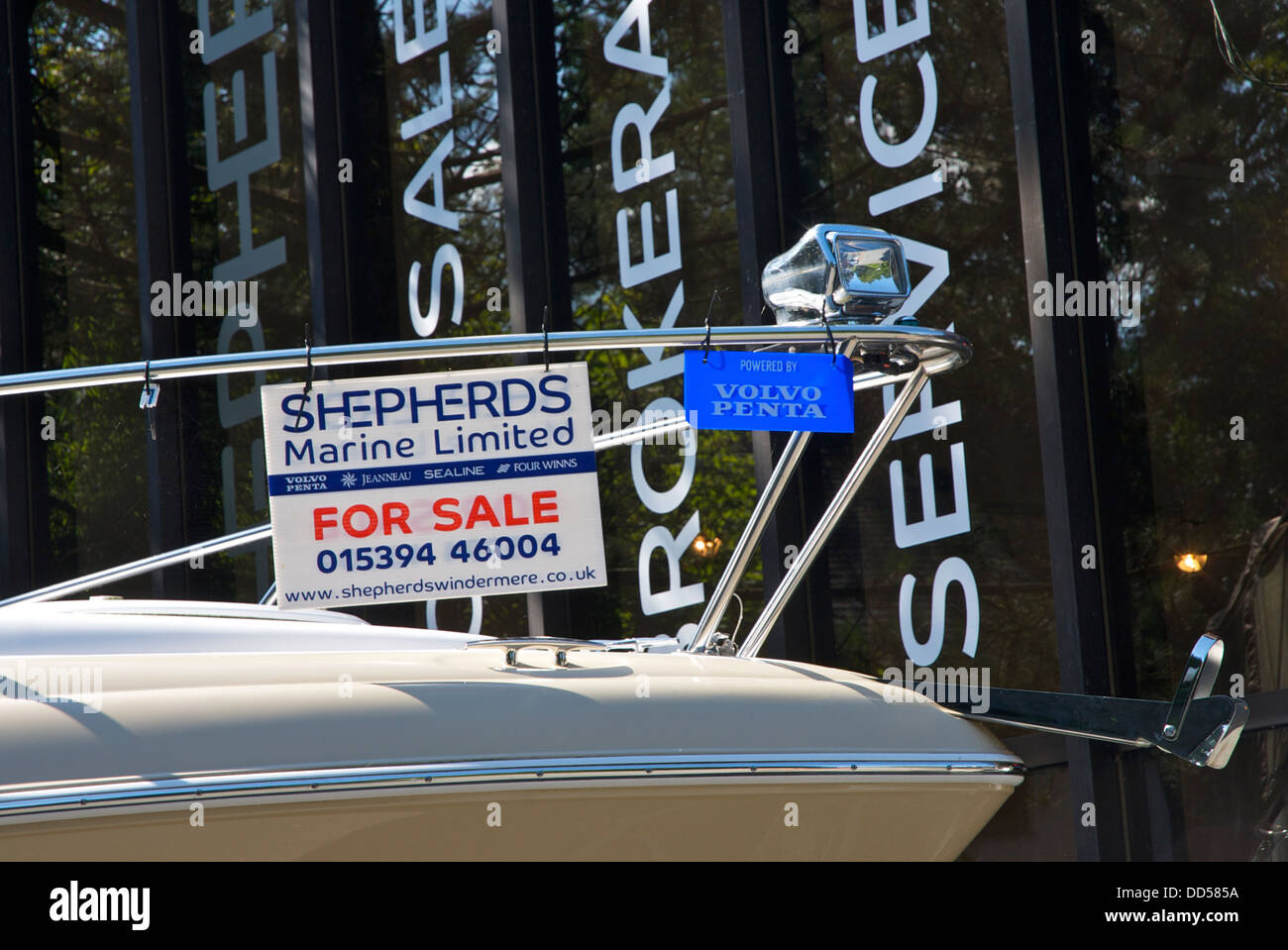 For Sale sign on speedboat, Bowness, Lake District National Park, Cumbria, England UK - Stock Image