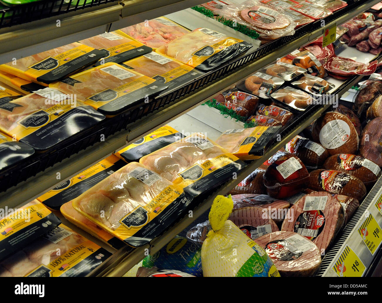 Meat and poultry counter at a grocery store - Stock Image