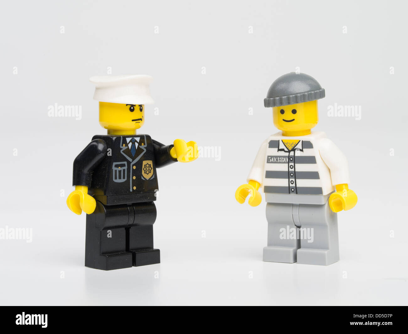 Lego police officer / guard with prisoner - Stock Image