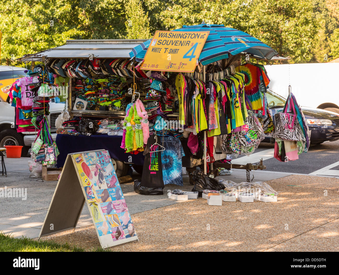 Typical street vendor selling souvenir T-shirts and gifts in Washington DC, USA - Stock Image