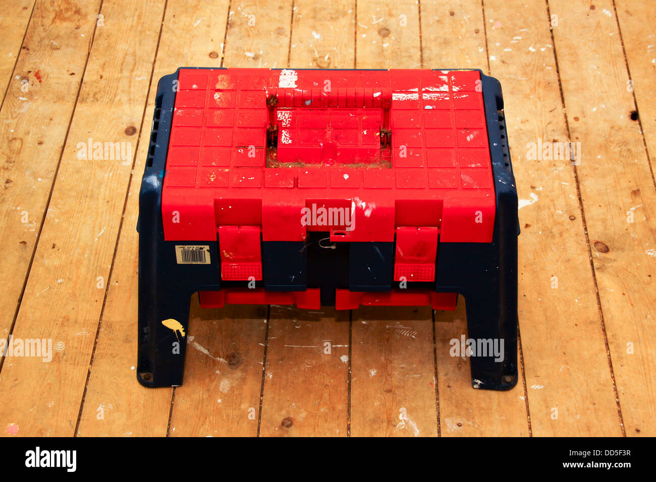 Step Stool Toolbox On Bare Floorboards Stock Photo