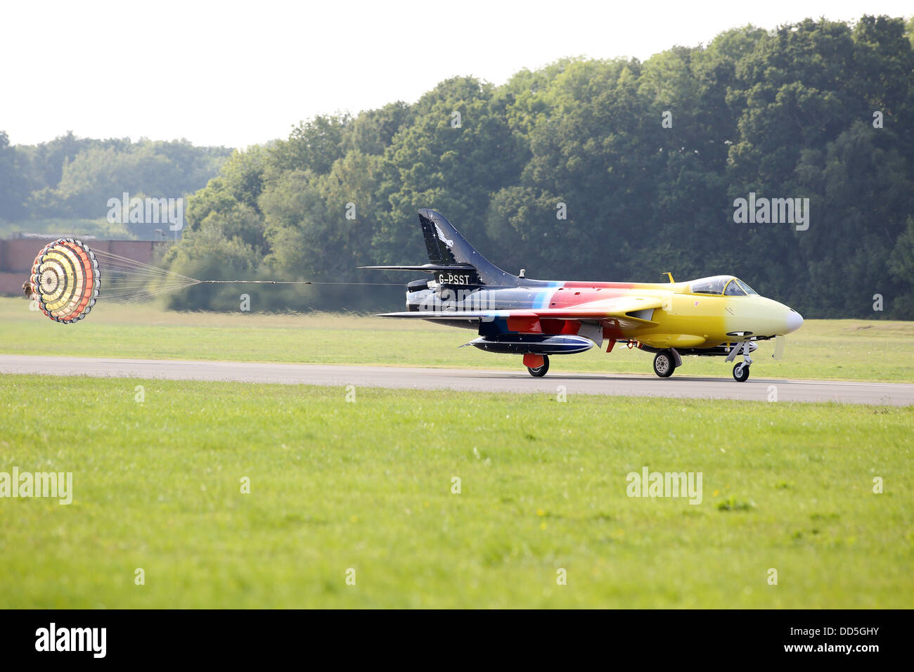 The Hawker Hunter (Miss Demeanour) pictured  at Wings and Wheels, Dunsfold, Surrey today with a spectacular display.The Stock Photo