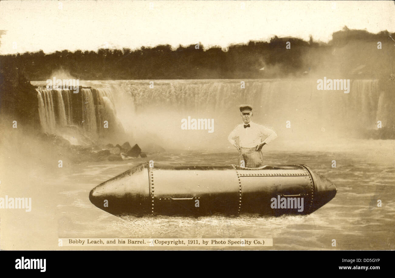 Bobby Leach, and his barrel. Postcard showing a composite photograph of daredevil Bobby Leach standing in the steel - Stock Image