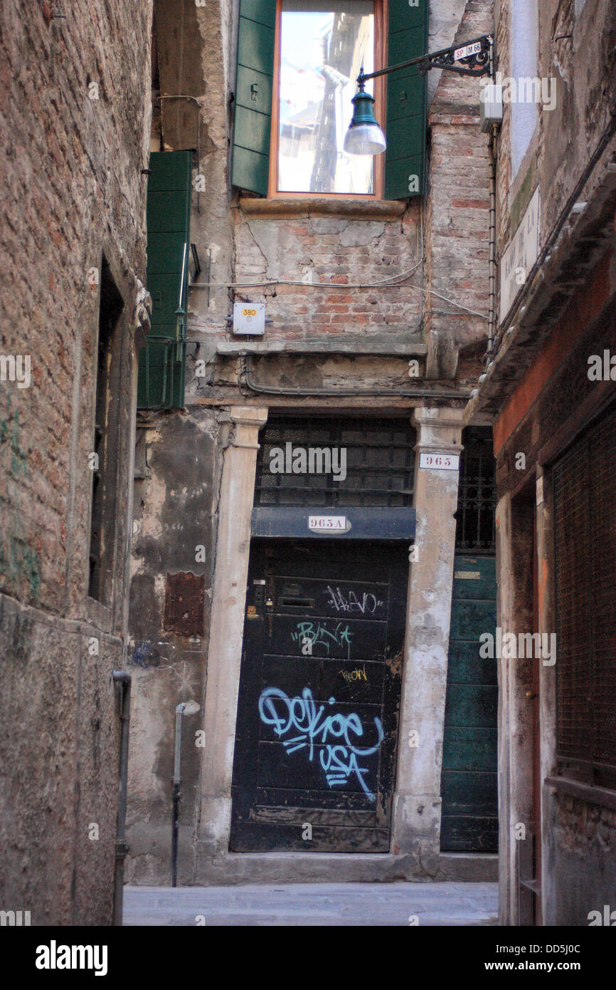 Leaning door of a building in Venice - Stock Image