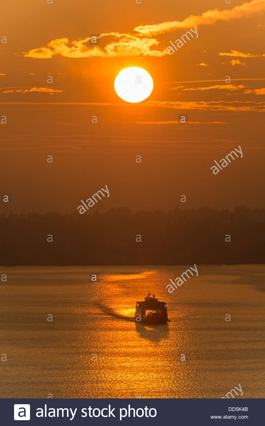 Germany, View of Ferry on Lake Constance at sunset - Stock Image