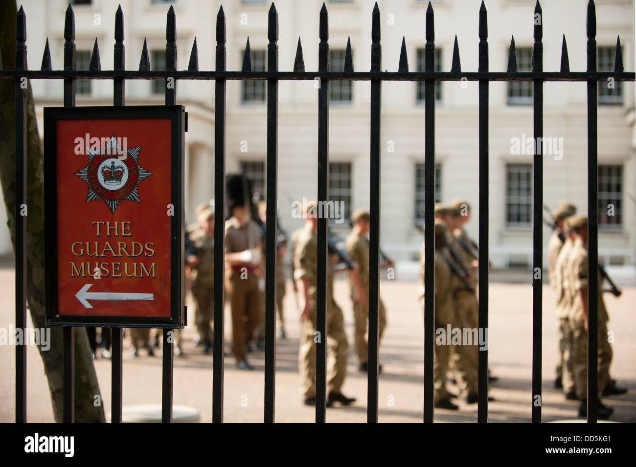 Guardsmen Square Bashing at Wellington Barracks in central London with sign to the Guards Museum - Stock Image