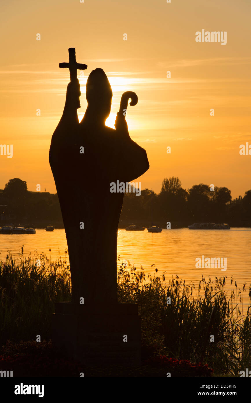 Germany, Statue of Holy Pirmin at sunset - Stock Image