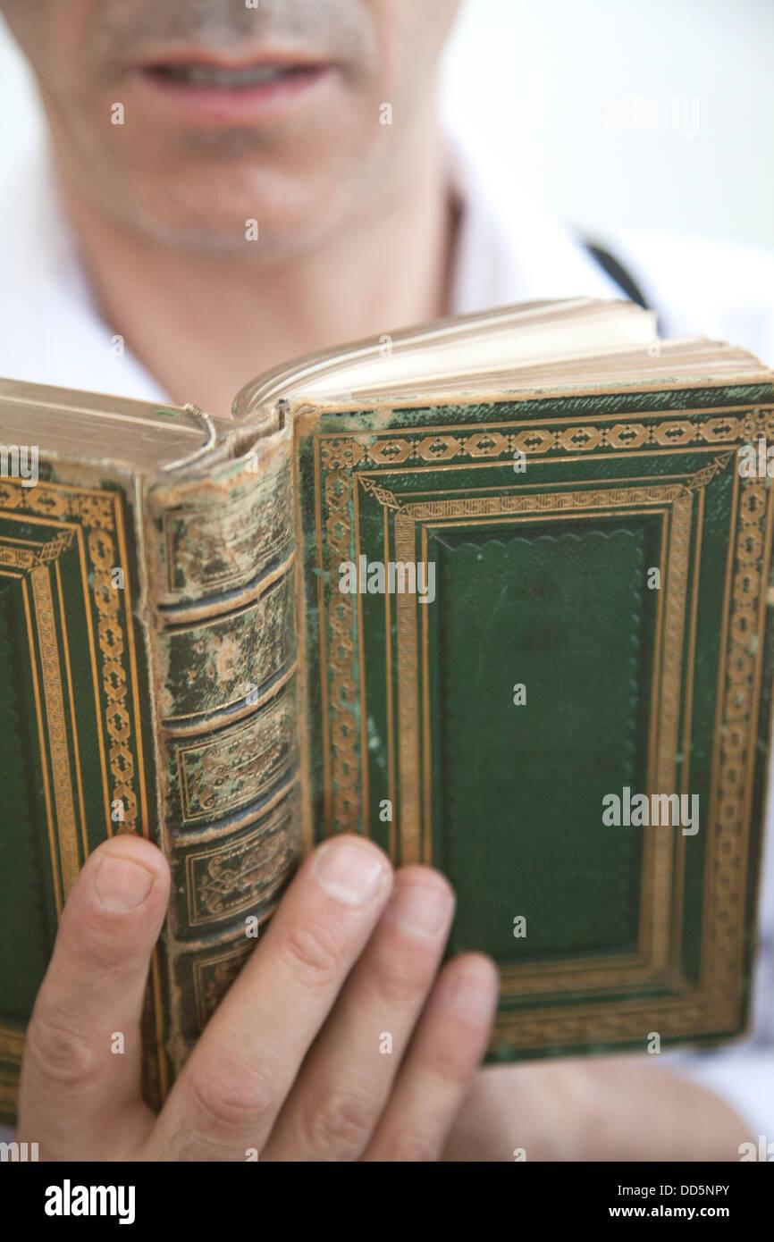 Man Reading Held Book - Stock Image