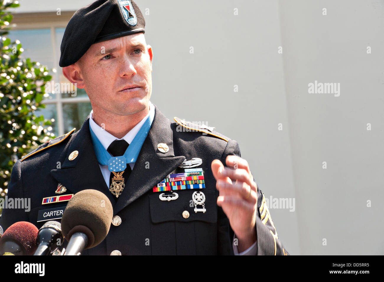 US Army Staff Sgt. Ty Michael Carter speaks to the press after receiving the Medal of Honor during a ceremony at - Stock Image