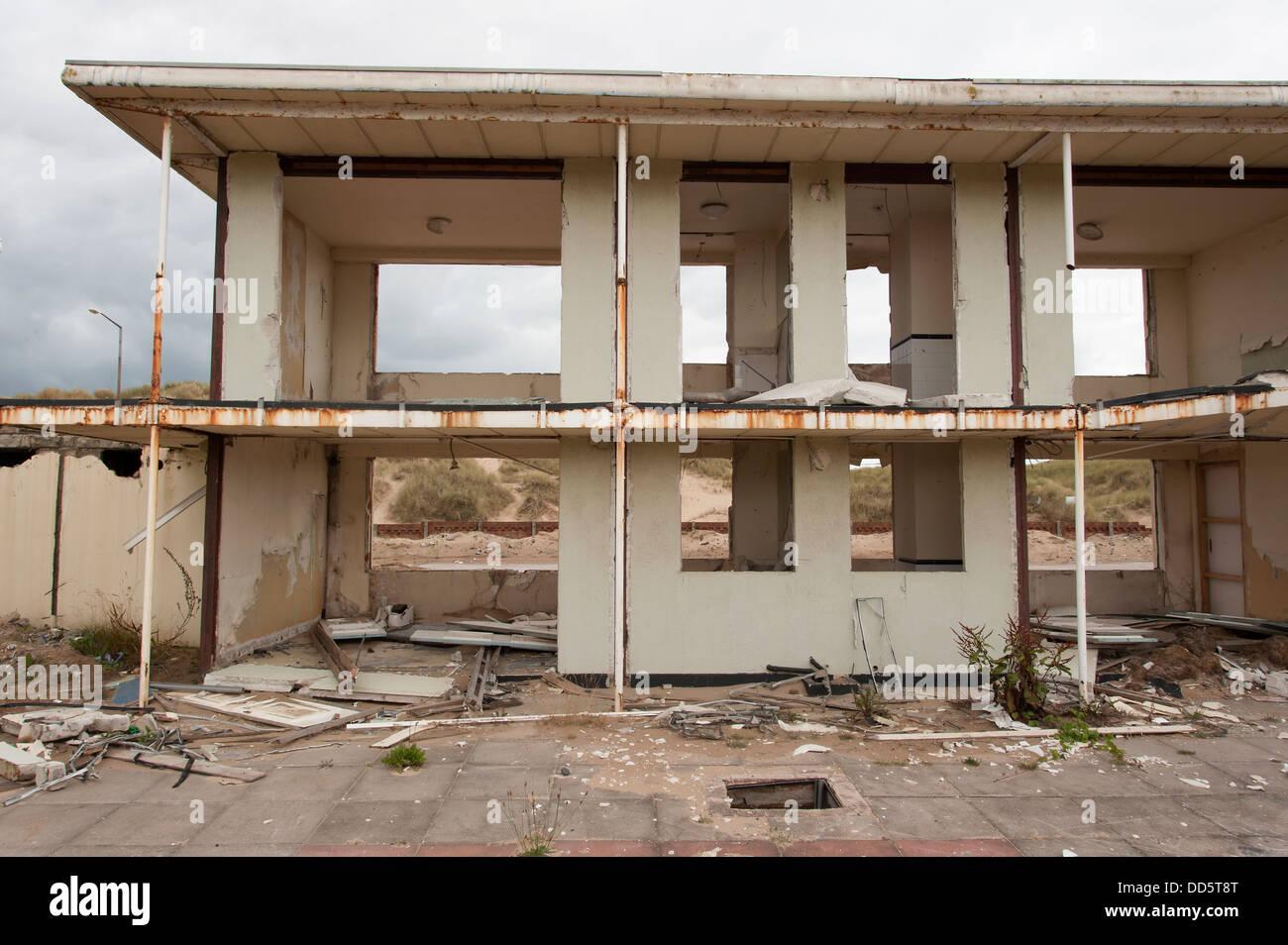 partly demolished mass tourism holiday camp - Stock Image