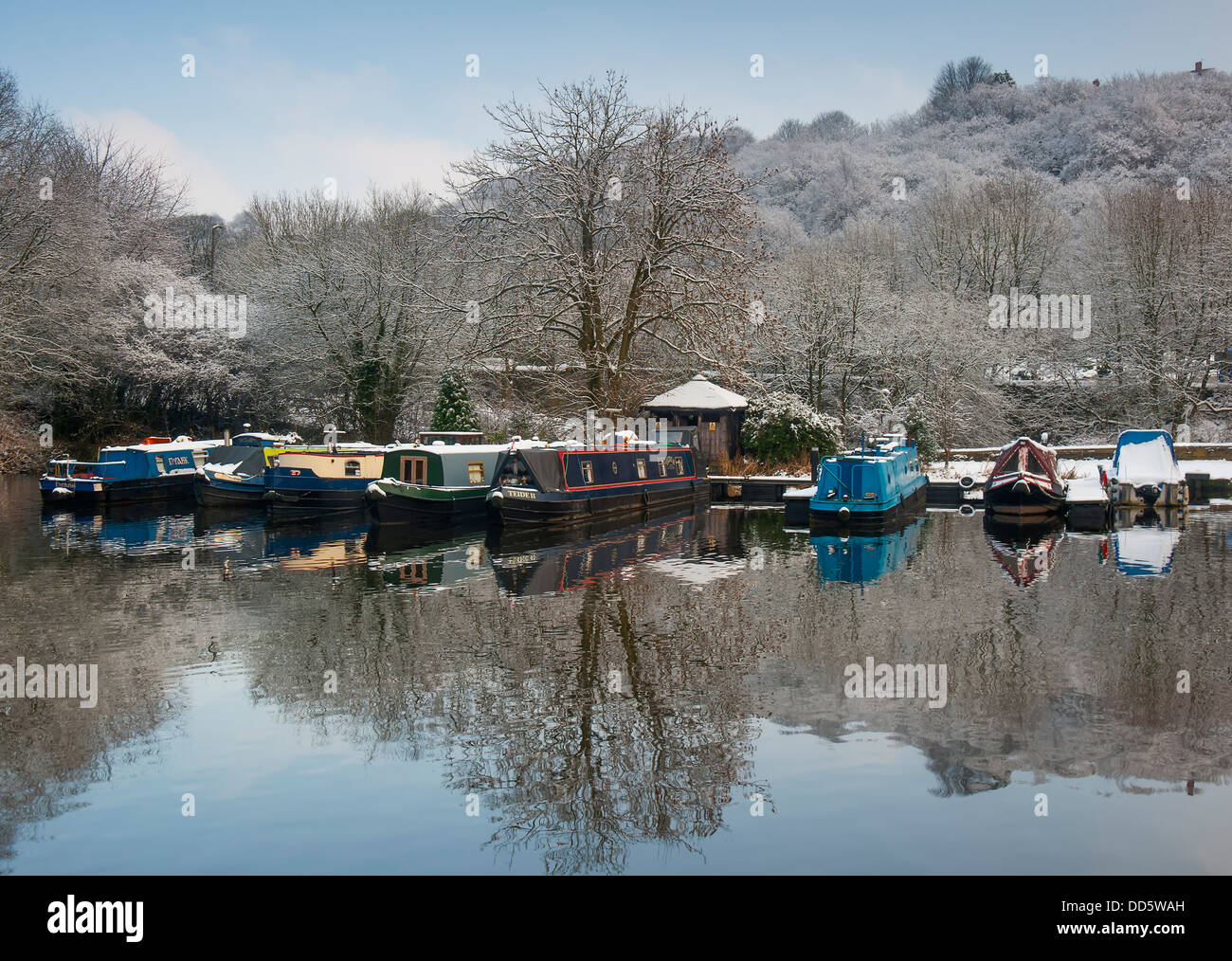 Canal narrowboats at their moorings on a clear cold winters day in yorkshire - Stock Image