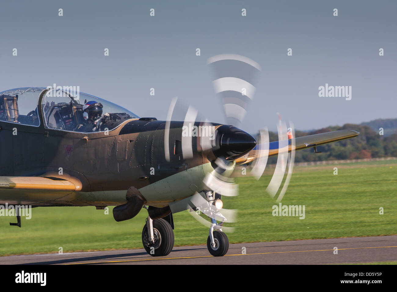 Aeroplane with spinning propellor preparing for takeoff at airshow, England, United Kingdom - Stock Image