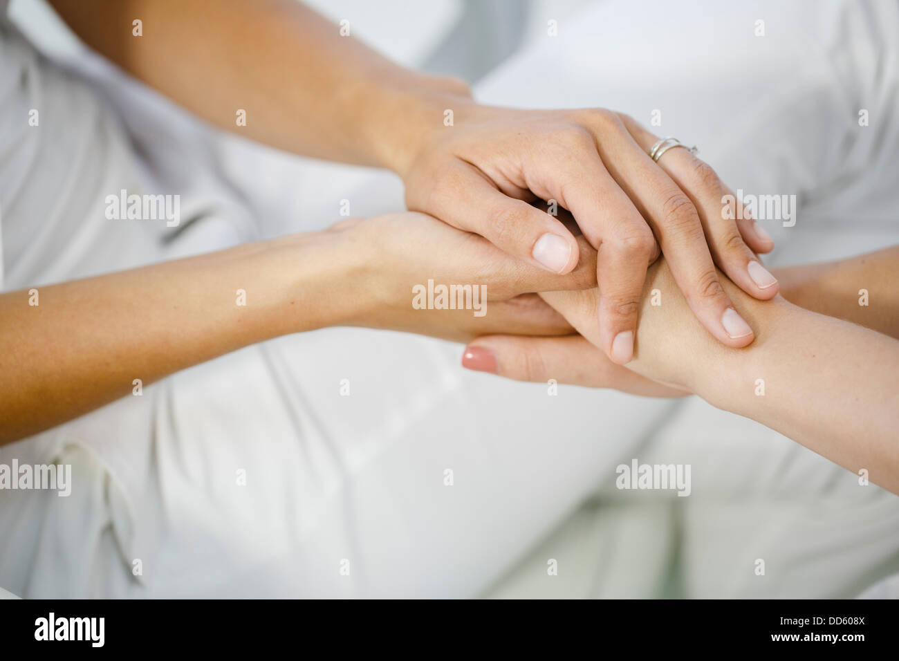 Doctor's Visit, Holding Hands, Close-up Stock Photo