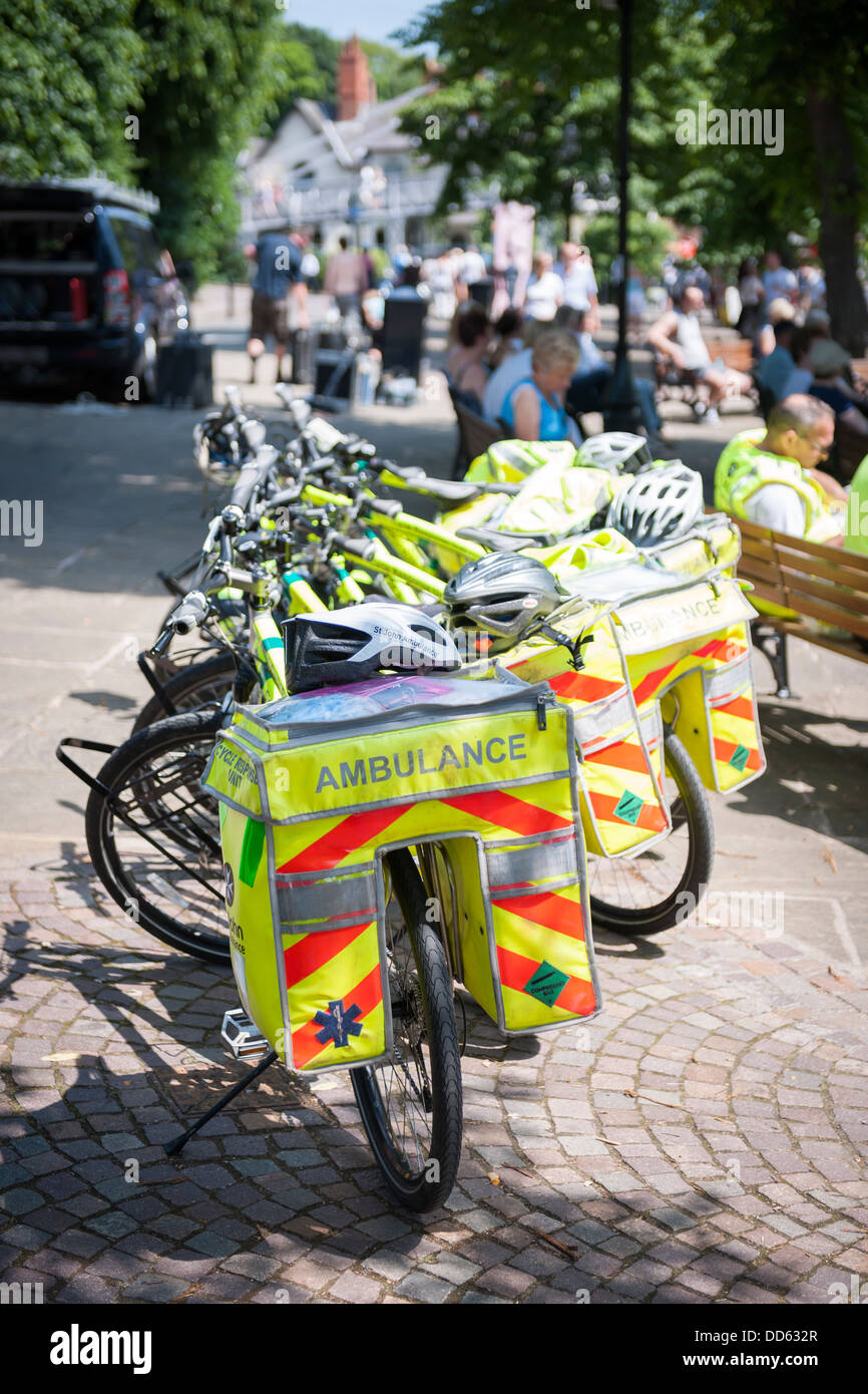 A group of St. John Ambulance cycling paramedics take a well earned rest in the The Groves on a sunny afternoon - Stock Image