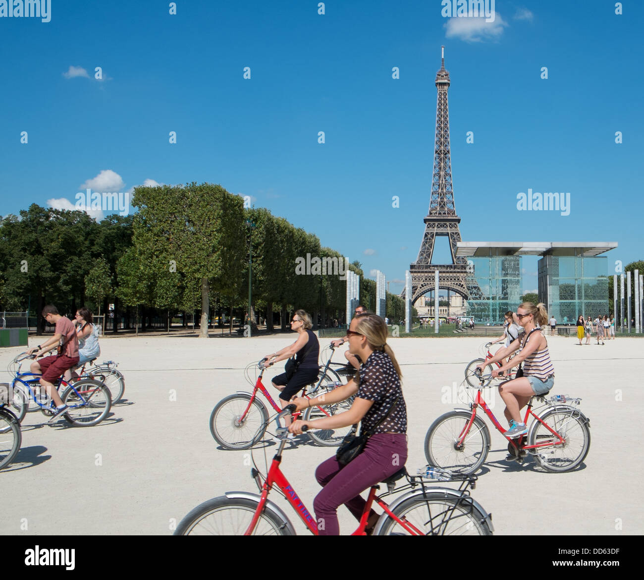 Bikers on the Champ de Mars by the Eiffel Tower in Paris France. - Stock Image