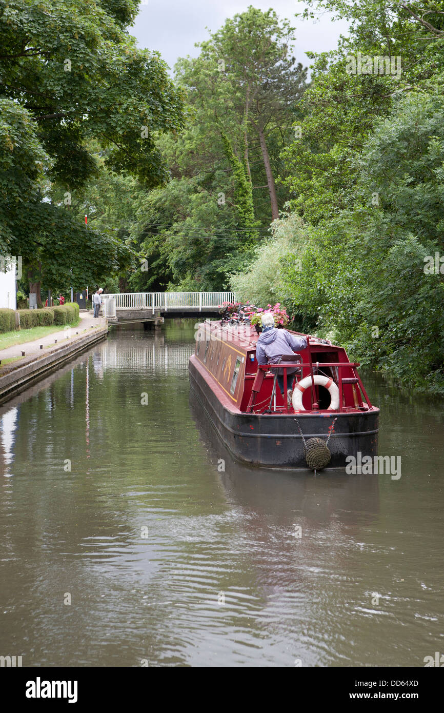 A narrowboat (barge) approaching the Theale swing bridge on the Kennet and Avon canal Berkshire. - Stock Image
