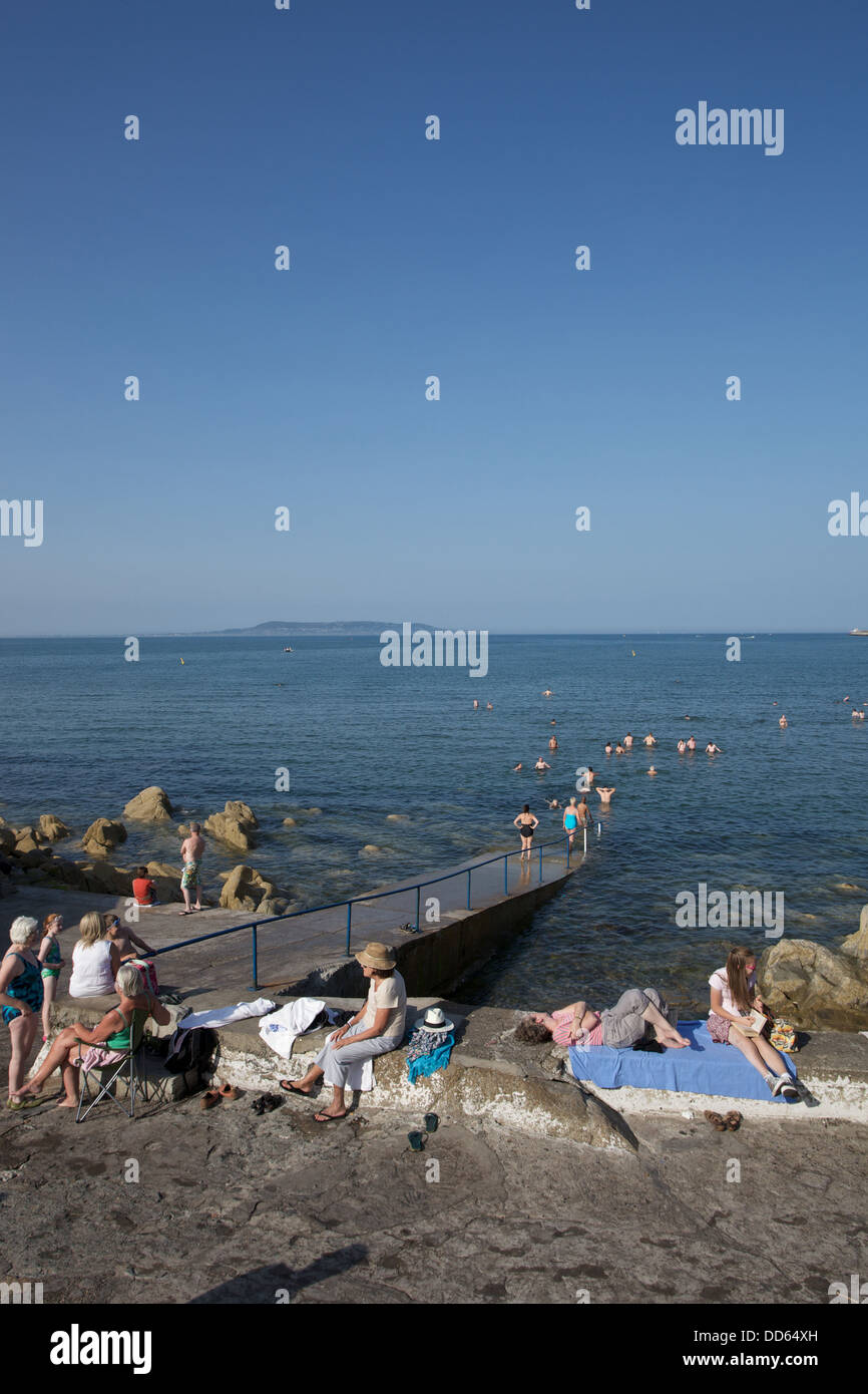 People at the seaside in Dublin city in Ireland. - Stock Image