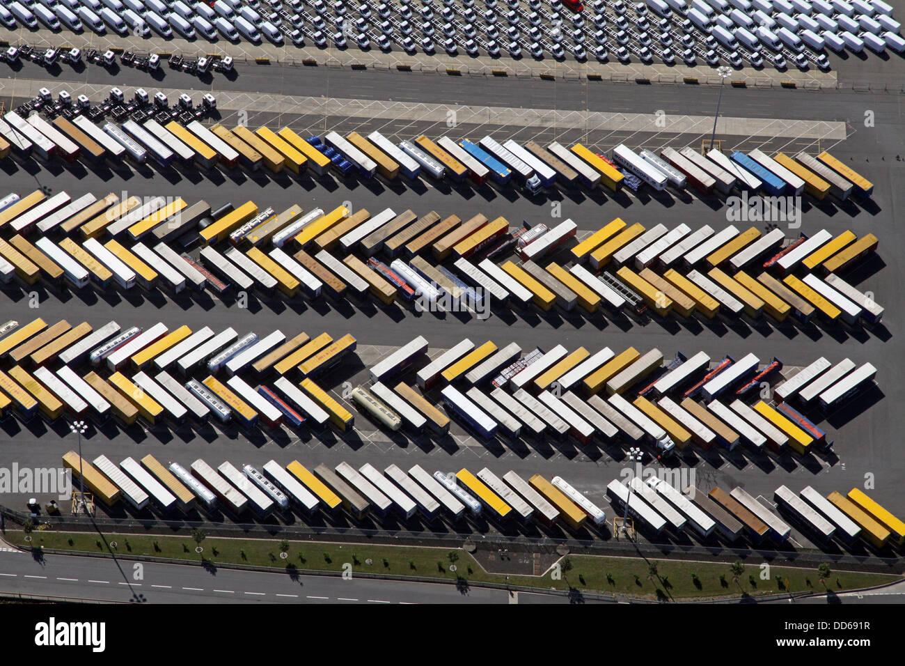 aerial view of lines of heavy goods vehicles, lorries and trucks parked on the quayside at Immingham, Lincolnshire - Stock Image