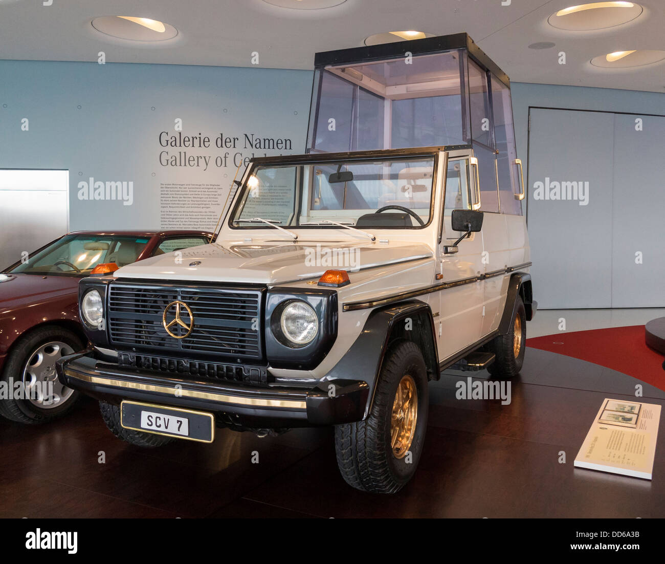 A 'Popemobile' on display at the Mercedes Museum in Stuttgart. - Stock Image