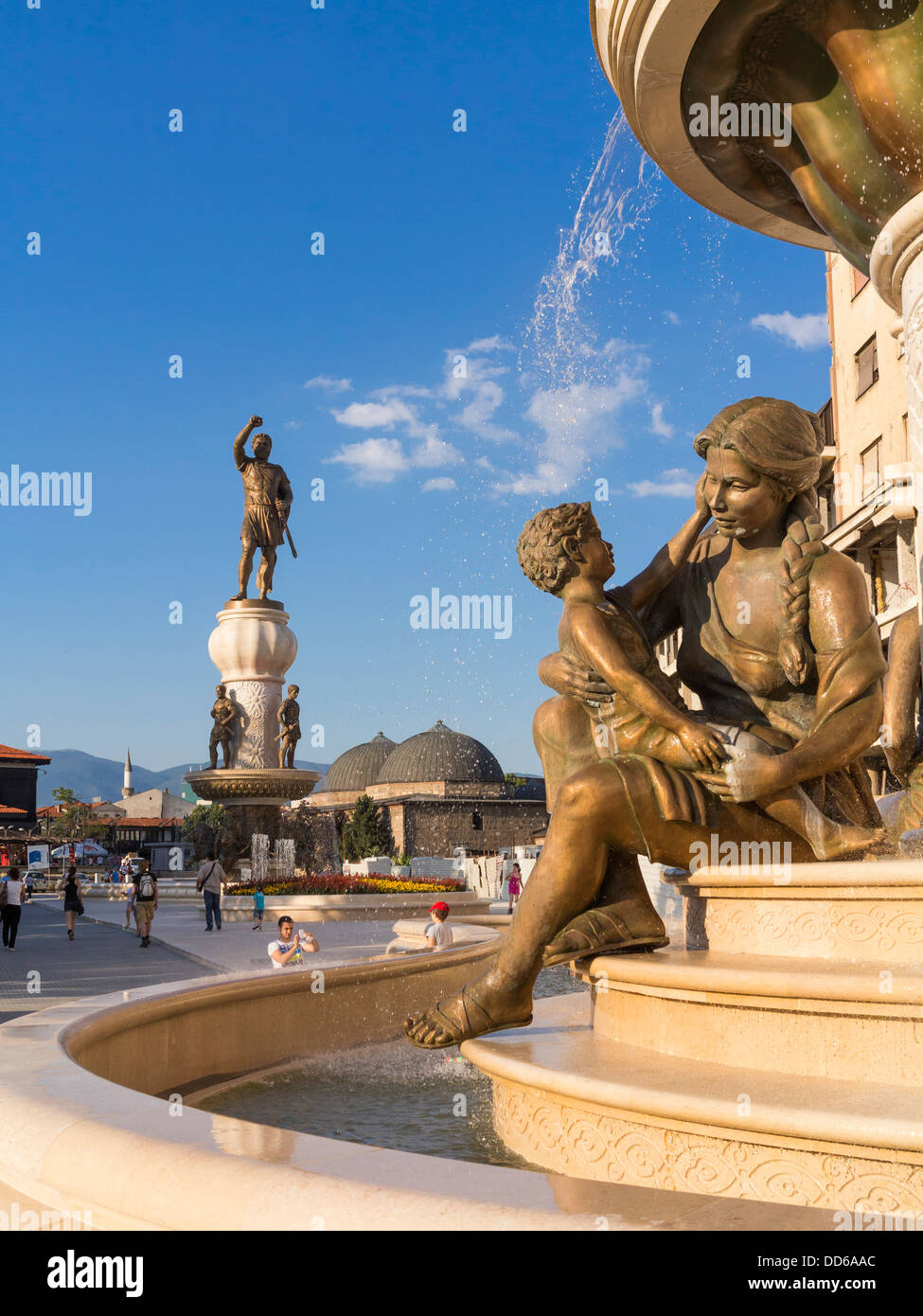 The Mothers of Macedonia Fountain, Skopje, Macedonia in Rebellion Square with the new Warrior Monument behind Stock Photo