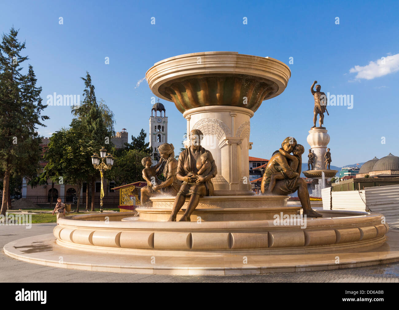 Skopje, Macedonia - Mothers of Macedonia Fountain statues, in Rebellion Square with Warrior Monument behind - Stock Image