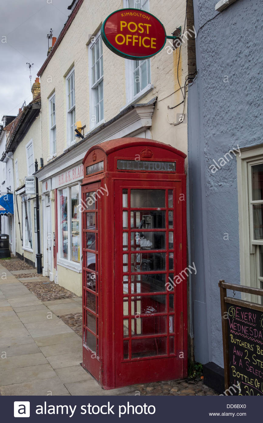 Post Office sign and red telephone box in Kimbolton, Cambridgeshire Stock Photo