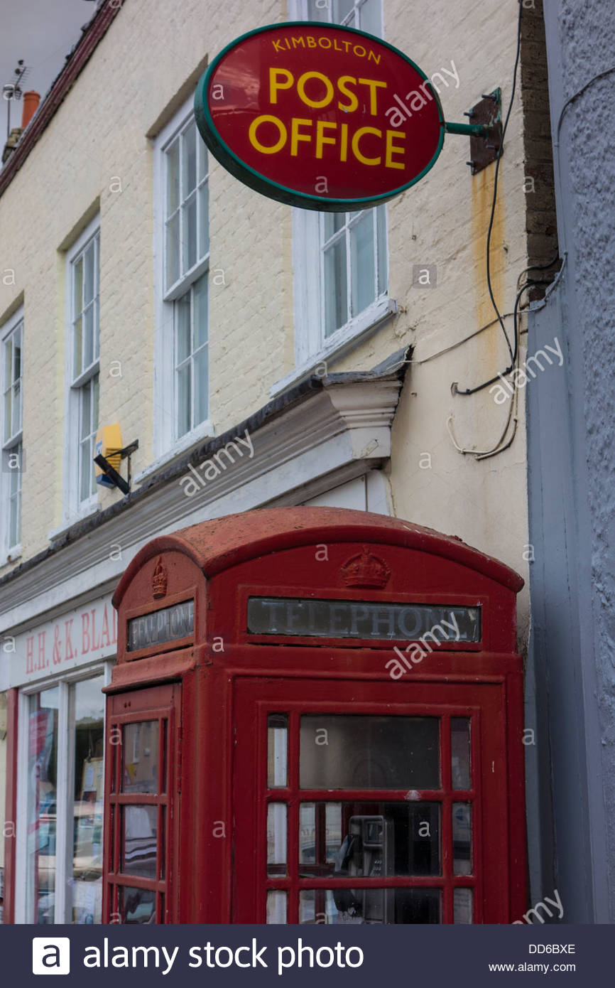 Post Office sign and red telephone box in Kimbolton, Cambridgeshire - Stock Image