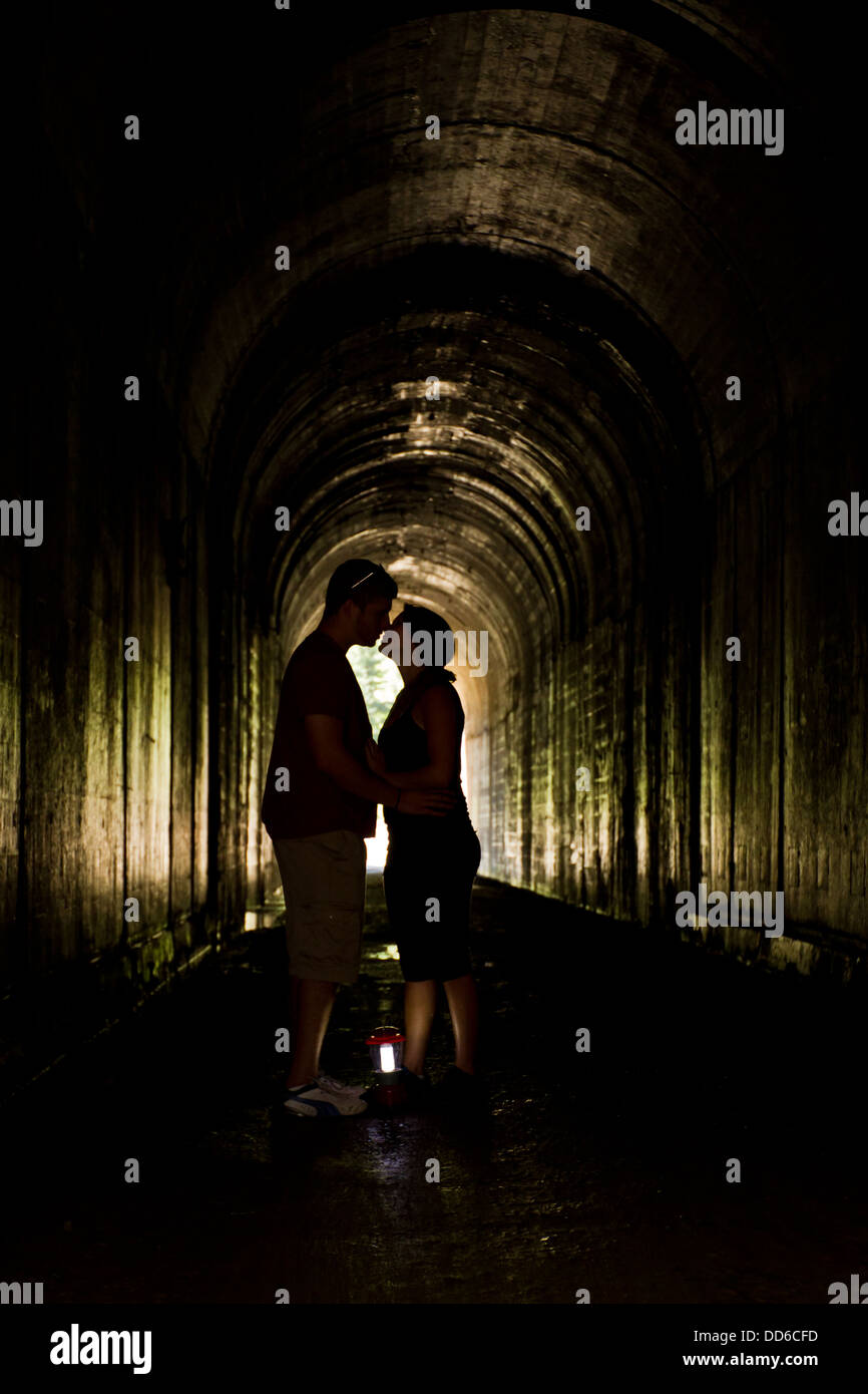 Stock Kissing A - Young Of Alamy Photo Tunnel 59763185 Couple Dark Inside