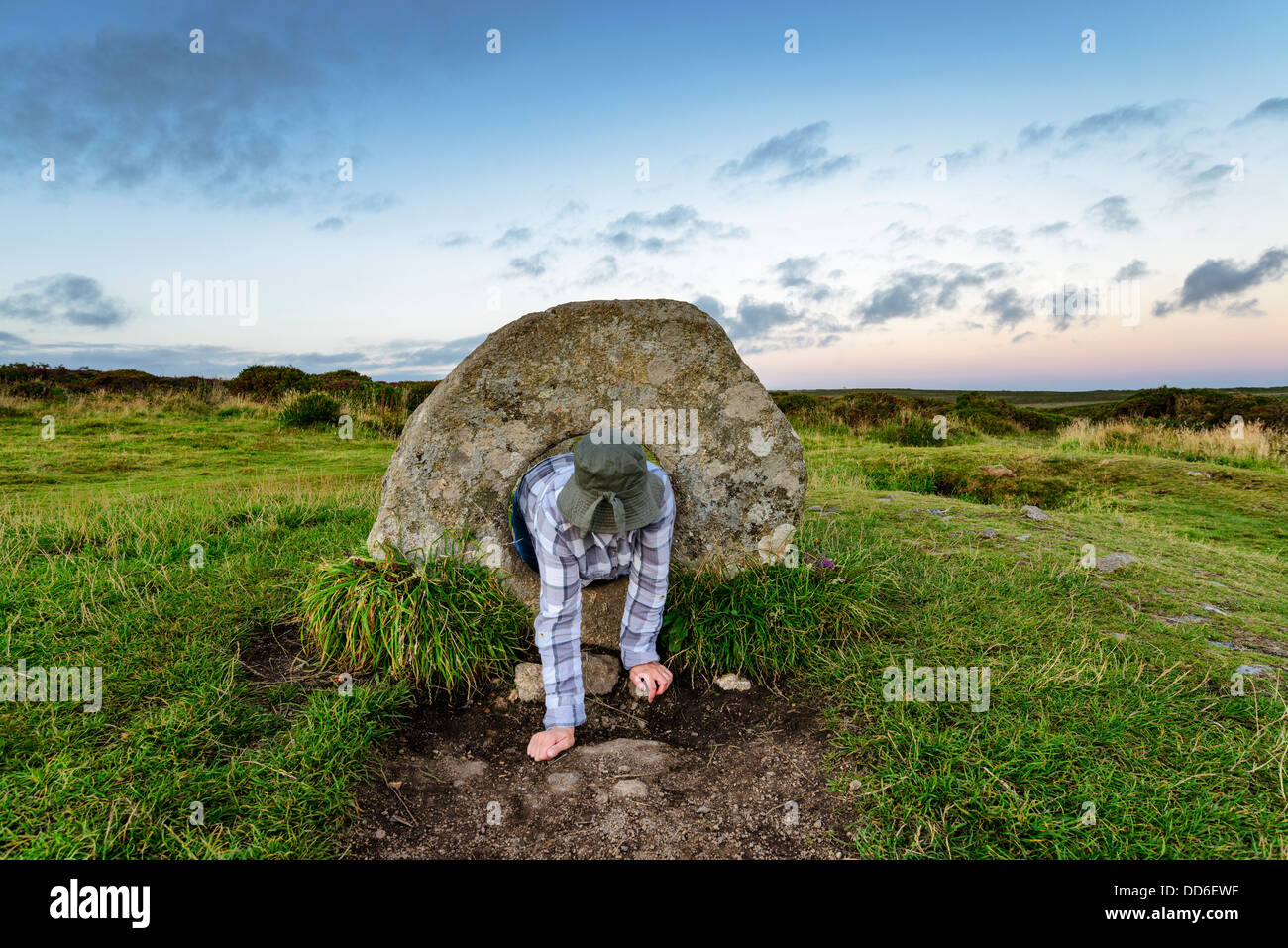 The Men-an-Tol standing stones Near Penzance in Cornwall, local legend says that a person passing through the holed - Stock Image